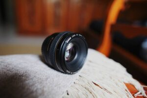 Canon 50mm DSLR lens on a surface covered with a shawl
