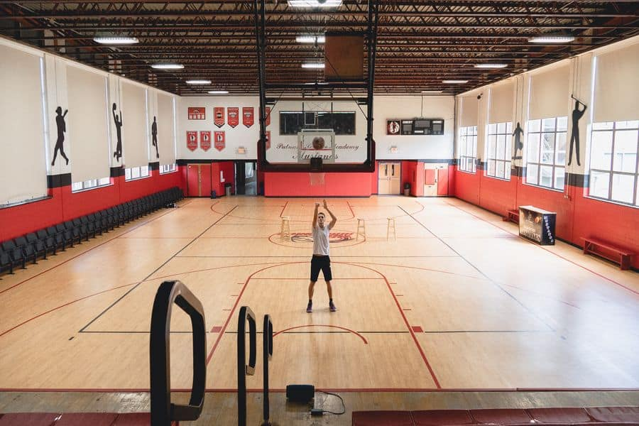 Player practicing in a basketball gym