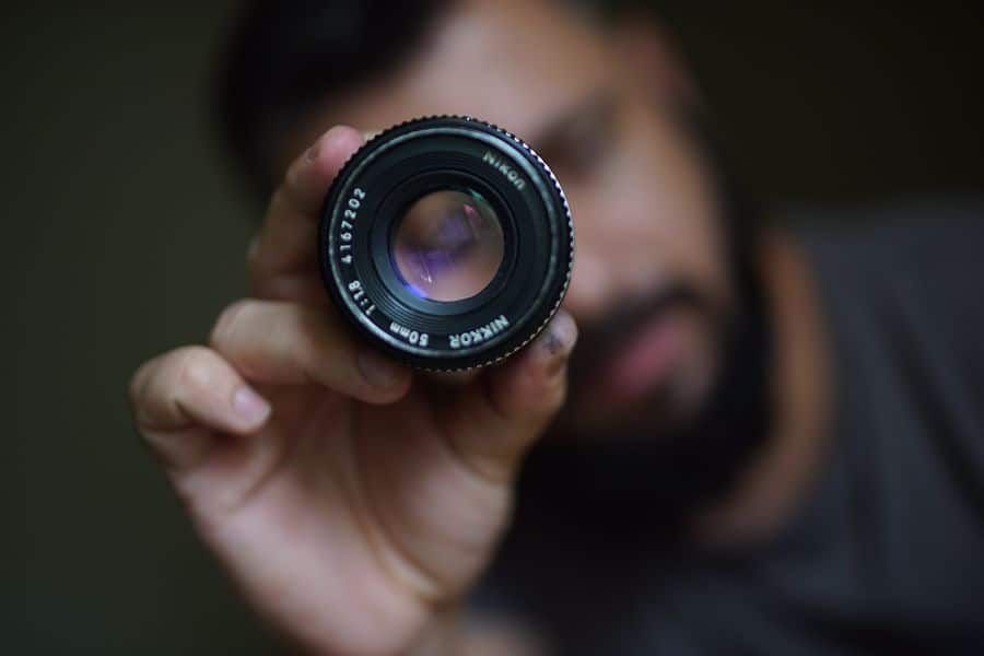 Person holding a 50mm lens