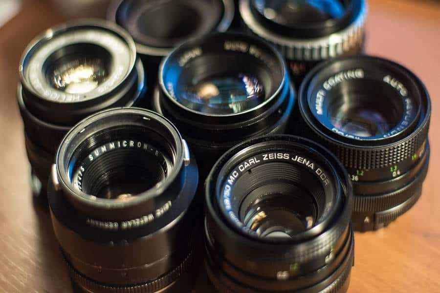 Vintage camera lenses on a table