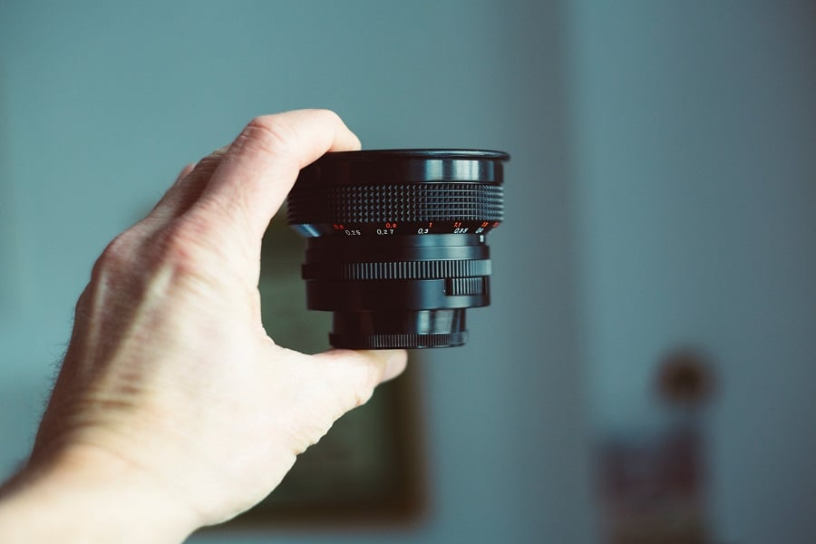 Person holding an analog vintage lens