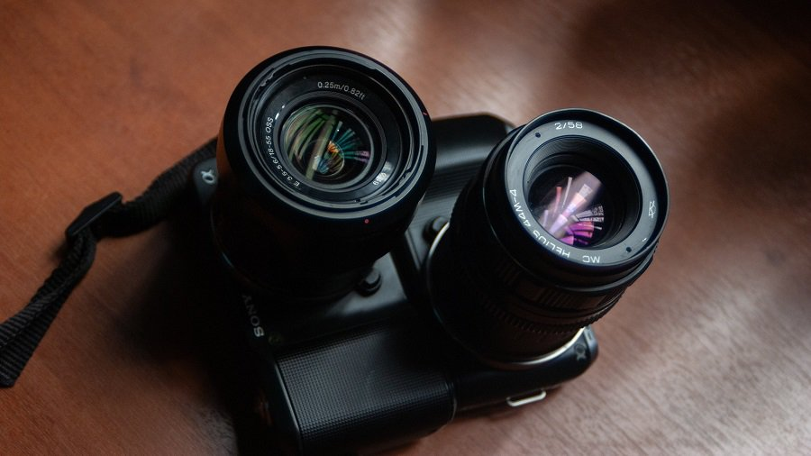 Two vintage camera lenses on a table