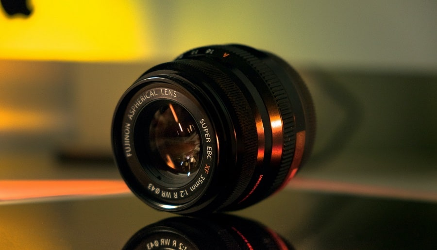A Fujinon 35mm lens on glass surface