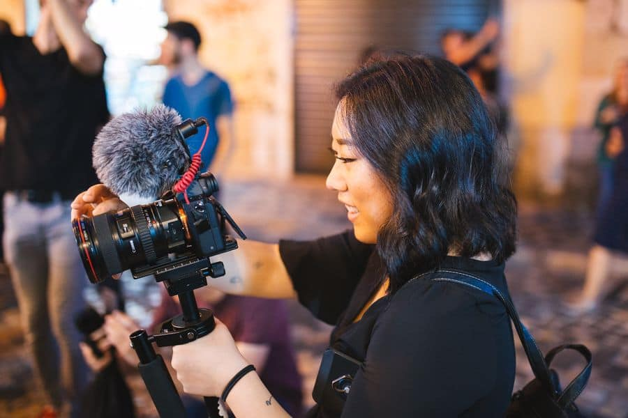 Woman vlogging an event