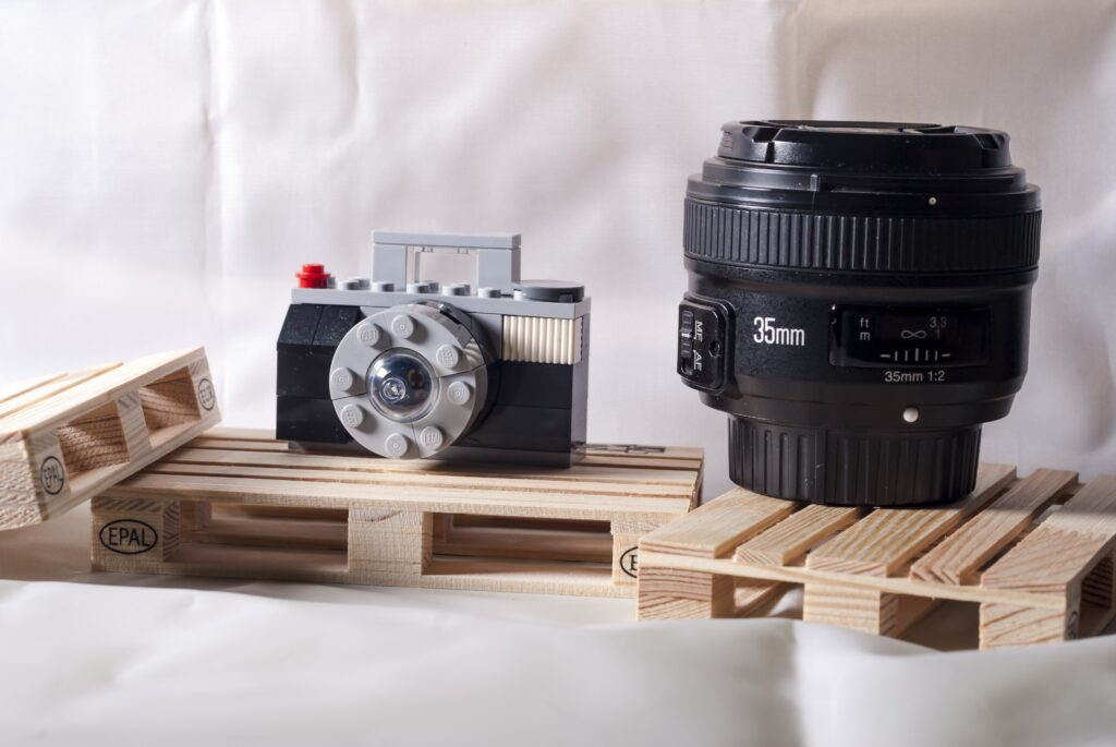 A 35mm lens and a lego of a camera on display