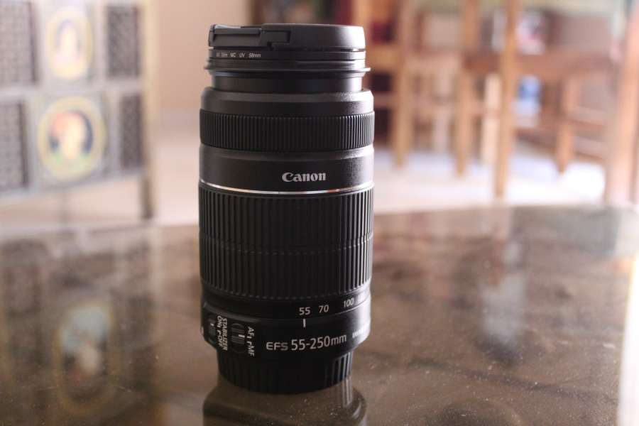 A Canon 55-250mm lens on a table