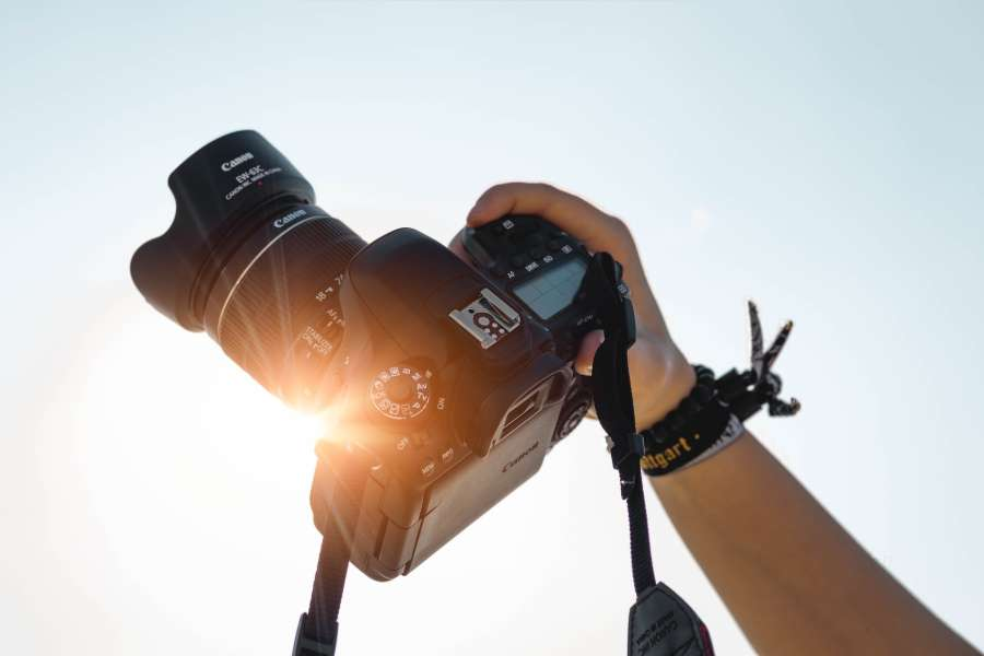 Hand holding a camera against sunlight