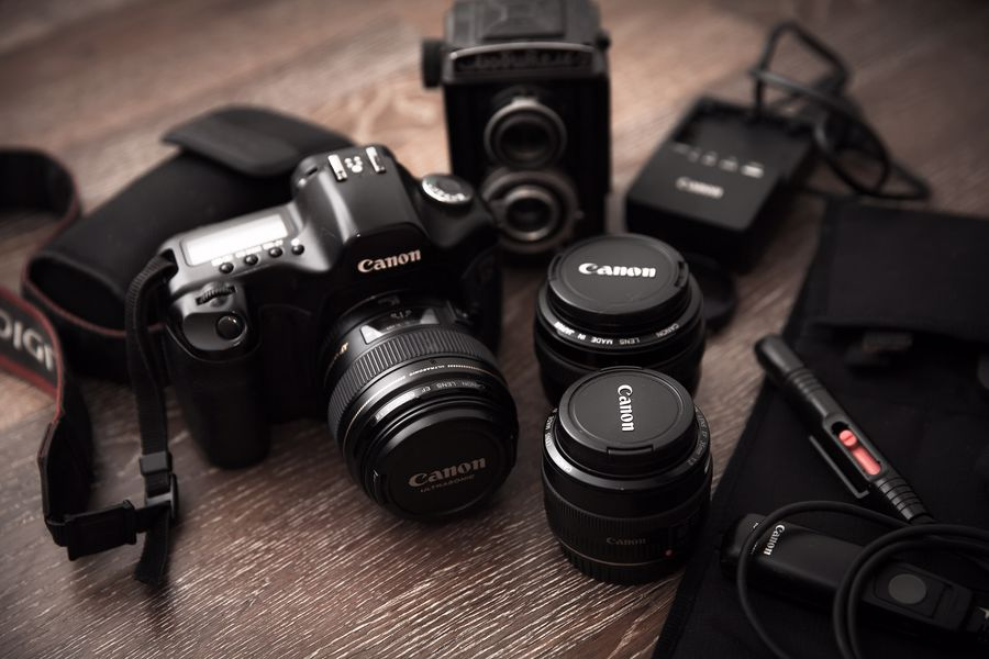 Canon camera with various lenses and gears