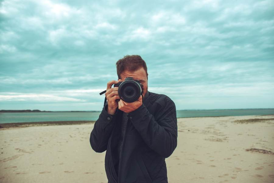 A photographer taking pictures at the beach